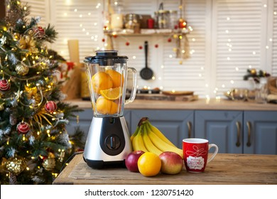 Christmas in the kitchen.Blender with fruit on the table