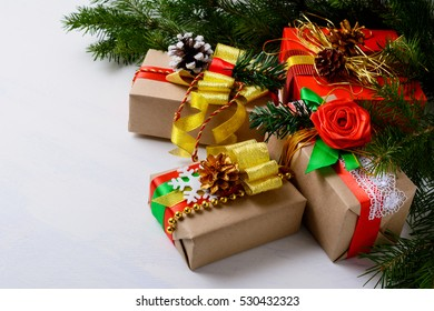 Christmas kraft paper wrapping presents with fir branches. Christmas background  with decorated gift boxes. Copy space