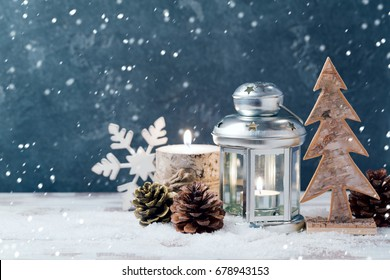 Christmas lantern and candle over dark background. Christmas holiday celebration concept