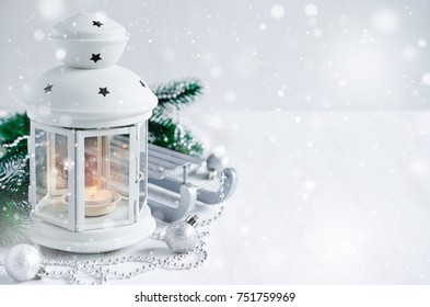 Christmas lantern with decorations over white wooden background. Magic lightning background, copy space