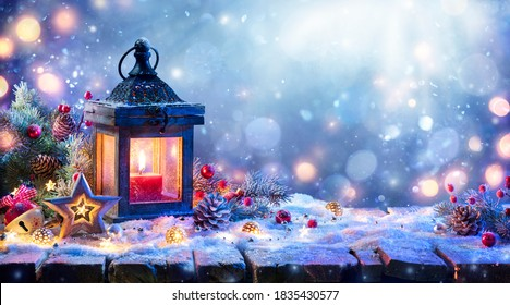 Christmas Lantern With Fir Branch and Decoration On Snowy Table - Defocused Background