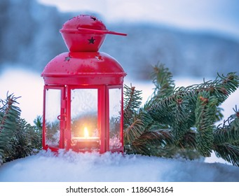 Christmas lantern with fir branches on snow