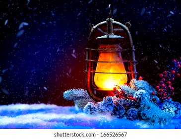 Christmas Lantern with miracle. Magic Stars. Winter Holiday Scene. Beautiful Background with Snow. Burning Old Styled lantern and christmas decoration in the evening. New Year art design