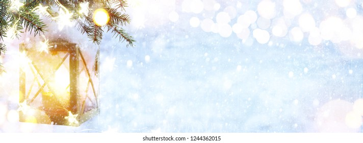 Christmas Lantern On Snowy Fir tree Branch. Winter Decoration Background