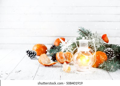 Christmas lantern on a white wooden background with New Year's attributes