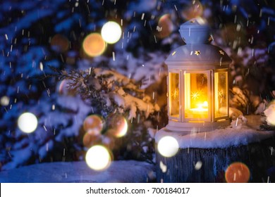 Christmas lantern with snowfall in the night