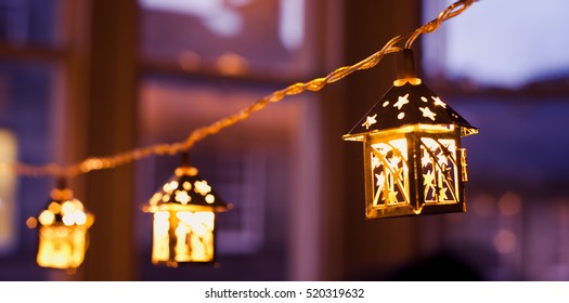 Christmas lanterns - bright evening lights.