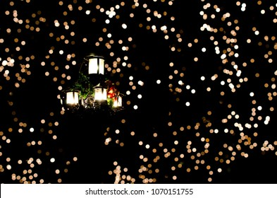 Christmas lanterns in front of a bokeh light background.