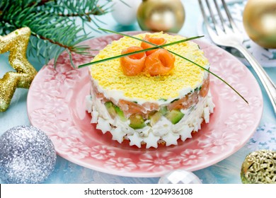 Christmas layered salad with salmon, avocado, rice and cream cheese salad on holiday table