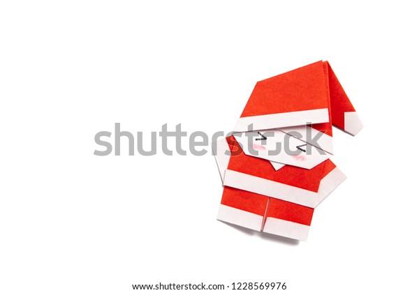 Christmas Leaflet Background.Christmas Leaflet White Background Santa Origami Stock Photo