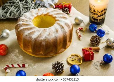 Christmas lemon pie near fair tree toys, cinnamon and dried orange.