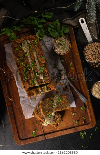 Christmas lentils loaf on dark kitchen countertop.