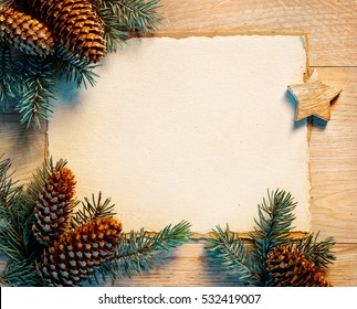 Christmas letter with fir branches,pinecones on wooden board. Merry Christmas and Happy New Year!! Top view.