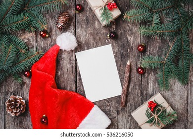 5905d7bcf7783 Christmas letter on wooden background with red Santa hat