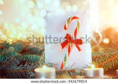 b009bd0e52f66 Christmas letter for Santa with candy canes and candle on light background.  Christmas decorations.
