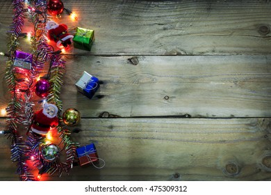 Christmas light background, colorful light on dark wood background with copy space