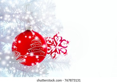 Christmas light background. Christmas decorations, red ball, snowflake, Christmas tree, on a white wooden background. New Year's holiday
