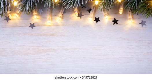 Christmas light background  with tree branches and Christmas  lights