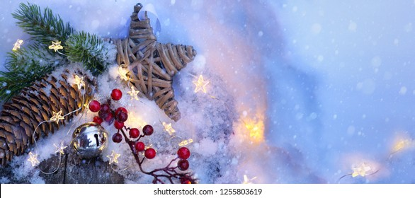 Christmas Light background. Xmas tree with snow decorated with garland star lights, holiday festive backdround. New year Winter or Christmas scene