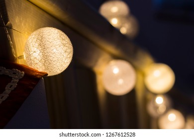 Christmas light balls as decoration on wooden railing. - Shutterstock ID 1267612528