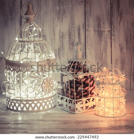 christmas light decoration in a white bird cage