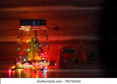 Christmas light in glass decor, vase.Light in bottle.