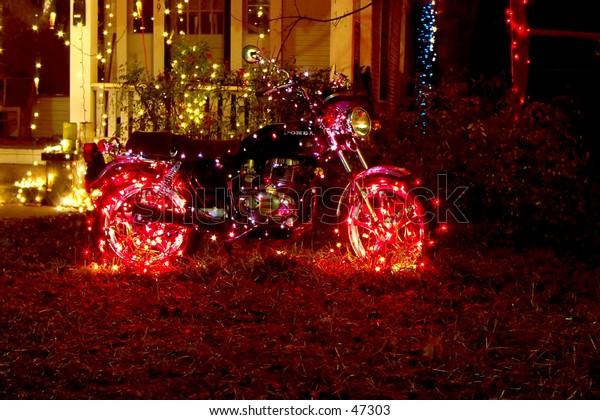 Christmas lights adorn motorcycle on 37th Street, Austin, Texas