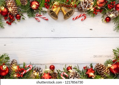 Christmas lights with balls,jingle bell and candy cane on wooden background