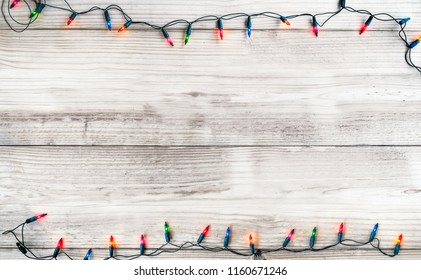 Christmas lights bulb decoration on white wood plank. Merry Christmas and New Year holiday background. vintage color tone.