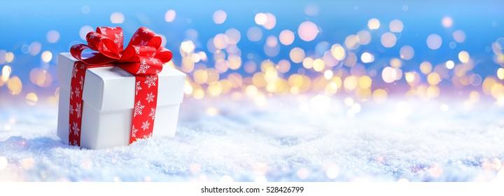 Christmas Lights Defocused On Snow