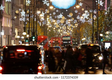 Christmas Lights Display on Oxford Street in London. The modern colourful Christmas lights attract and encourage people to the street.