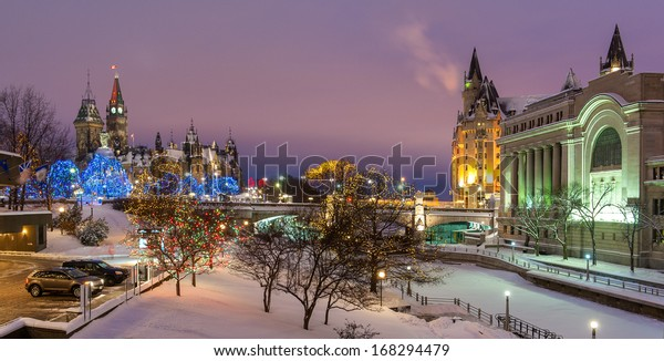 The Christmas lights in downtown Ottawa at night. View on the Rideau canal, the chateau Laurier and the Parliament