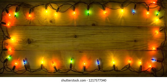Christmas lights frame background. Empty space for text or draw