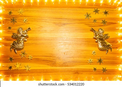 Christmas lights frame on golden wood background with copy space for your text.Christmas decoration. or New Year concept.