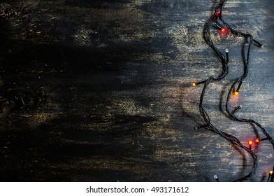 Christmas lights on dark rustic background