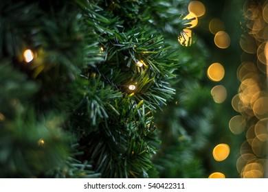 Christmas lights on plastic green grass texture