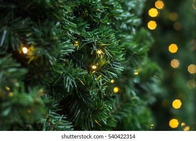 christmas lights on plastic green grass texture