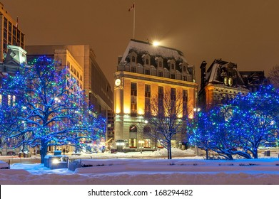 The Christmas lights and the snow in downtown Ottawa at night