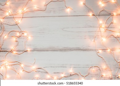 Christmas lights wooden background
