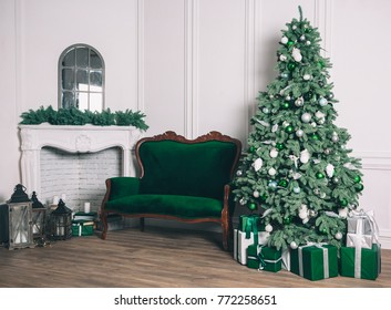 Christmas living room with a fireplace, sofa, Christmas tree and gifts. Beautiful New Year decorated classic home interior. Winter background