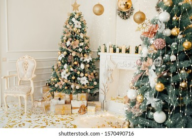 Christmas living room interior, decorated  mantelpiece, lit up trees with  gold green baubles and ornaments, stars, wreath, candles, cosy chair. Merry Christmas and Happy New Year