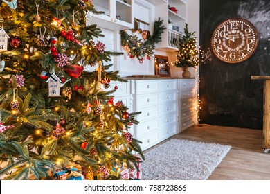 Christmas living room with a Christmas tree, gifts and clock. Beautiful New Year decorated classic home interior. Winter background.