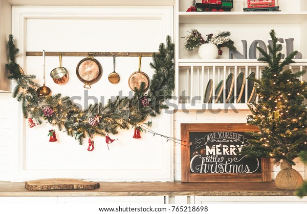 Christmas living room with a Christmas tree, gifts.Dining room. Beautiful New Year decorated classic home interior. Winter background