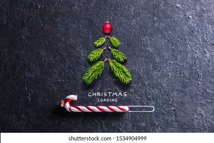 Christmas Loading Concept - Tree And Candy Cane On Black Stone