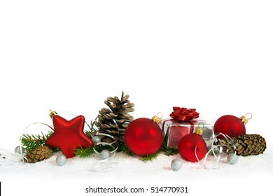 Christmas lower decoration with balls, cones and gift on white background.