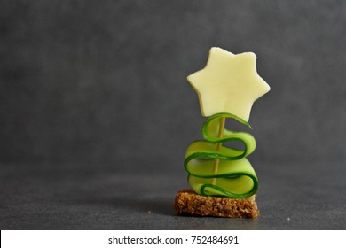 Christmas made out of wholemeal bread, cucumber and cheese