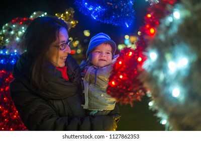Christmas magic, mother and cute boy near New Year decoration