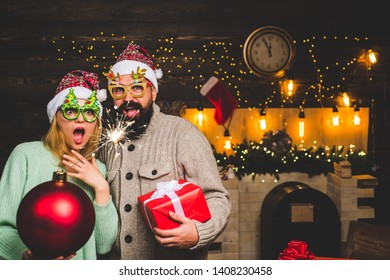 Christmas man hold bomb. Christmas sale. Happy couple in Santa hat at Xmas family party. New year party in home