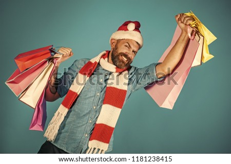 68a0dd939c283 Christmas man shopper happy smile in santa hat and scarf. Black friday sale  concept.