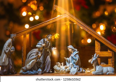 Christmas Manger scene with figurines including Jesus, Mary, Joseph, sheep and wise men. Focus on baby!
